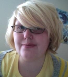 Valerie Smiling with glasses and blond hair