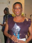 Photo of Claudia Booker in purple dress