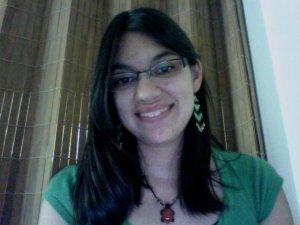 Raeanne smiling in a green shirt