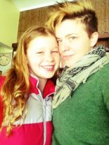 Angela wearing green sweater with a younger person wearing a red jacket
