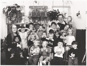 Group photo of kids and adults, black and white.