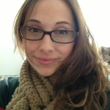 Photo of Karly with glasses and scarf