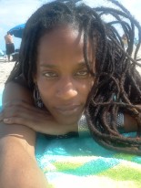 Lisa lying down with braids