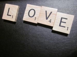 "Scrabble tiles spelling out ""love"""
